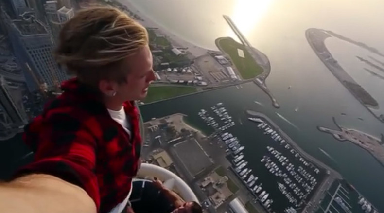 Russian vertigo-defying 'rooftopper' backflips on the edge of a 101-story building (VIDEO)