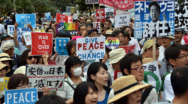 Thousands rally in Japan against controversial overseas military deployment bill (PHOTOS)