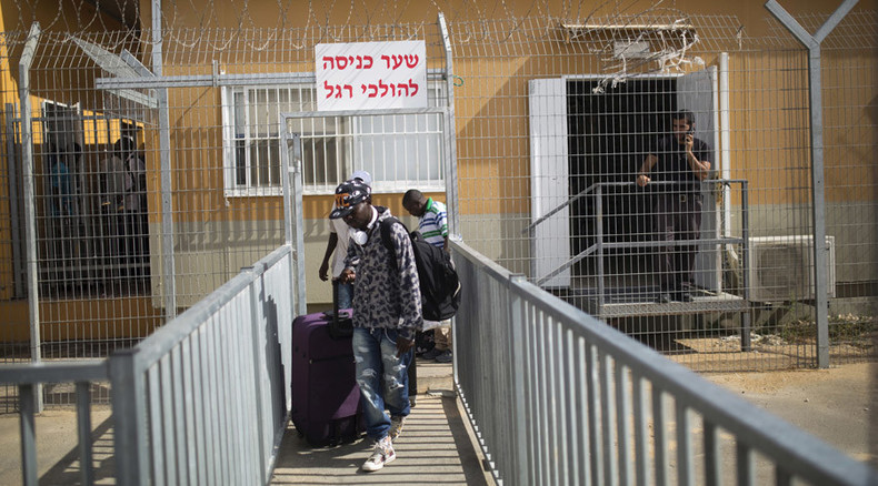 1,100 migrants banned from Tel Aviv, Eilat after spending 12+ months in desert detention center
