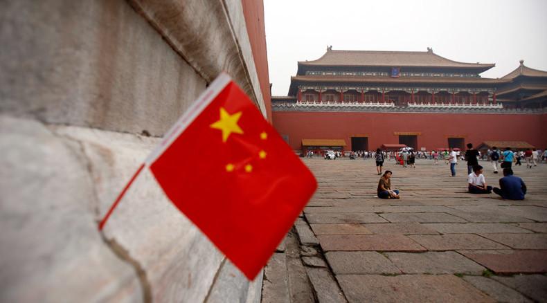 China stocks down again on volatile global trading