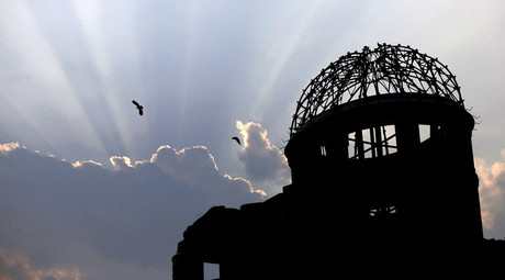Birds fly over the Atomic Bomb Dome in Hiroshima, western Japan July 29, 2015. © Issei Kato