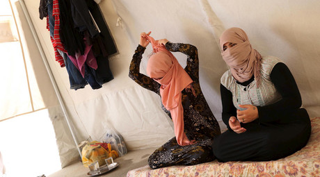 Yazidi sisters, who escaped from captivity by Islamic State (IS) militants, sit in a tent at Sharya refugee camp on the outskirts of Duhok province July 3, 2015 © Ari Jala