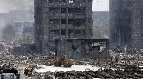Damaged buildings and cars are seen near the site of the explosions at the Binhai new district, Tianjin, August 13, 2015. © Jason Lee