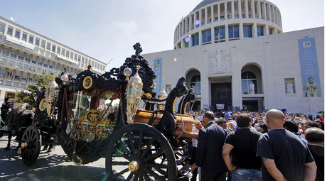 An ornate hearse pulled by six, black-plumed horses, carries the body of Vittorio Casamonica to a Roman Catholic basilica in the Rome suburbs, where the funeral mass was celebrated, August 20, 2015. © Stringer