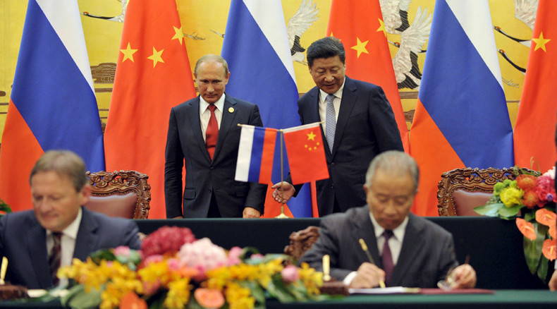 Energy goes east as Russia and China seal multibillion dollar deals in Beijing