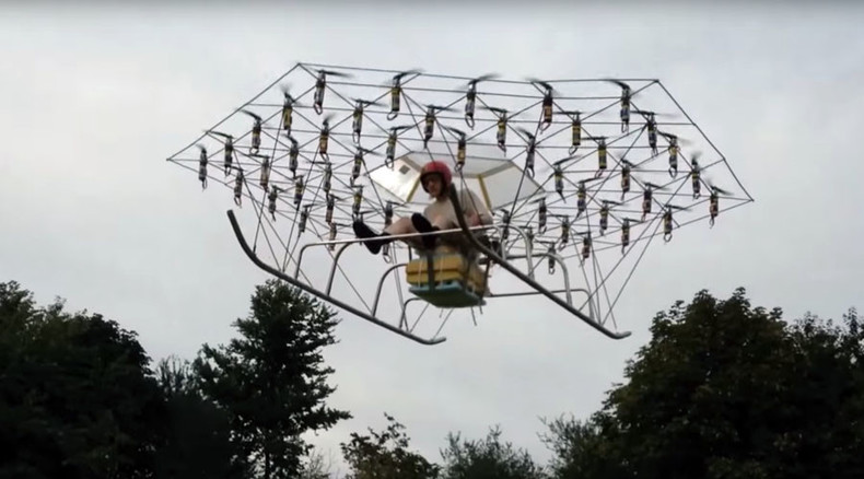 British man builds helicopter from 54 drones & garden chair (VIDEO)