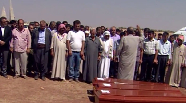 'I blame myself': Father of drowned kids lays family to rest at home in Kobani (VIDEO)