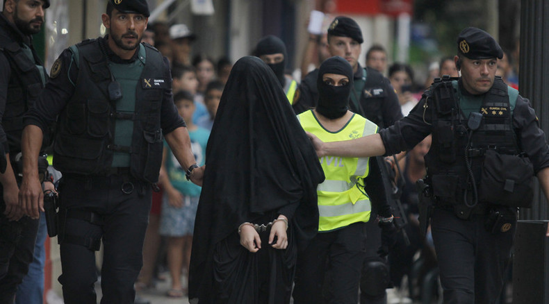 Teenage 'ISIS recruiter' caught in Spain, paraded handcuffed through streets