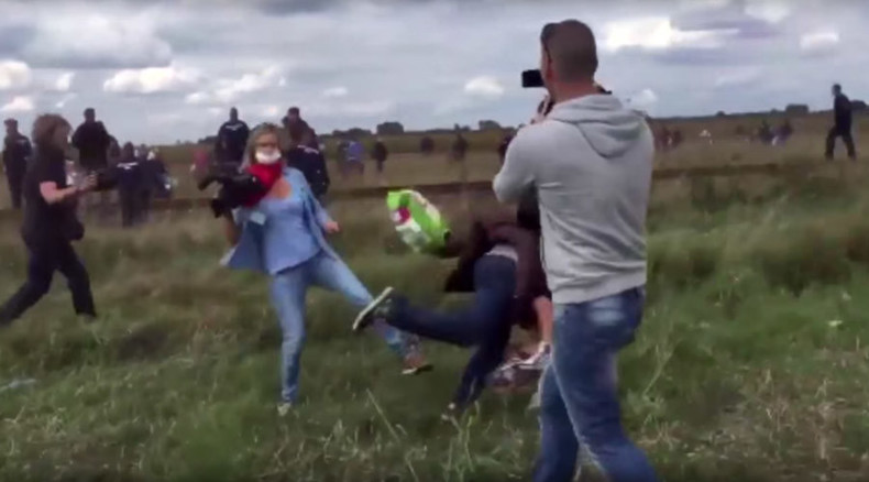 Hungarian journalist fired after kicking, tripping up refugees on video