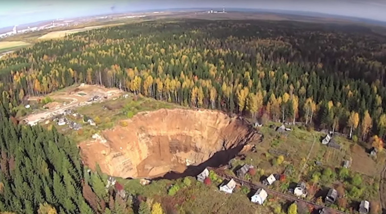 Drone gets terrifying glimpse of growing sinkhole in northeast Russia (VIDEO)