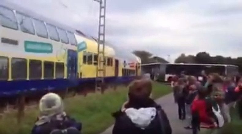 Train crashes into school bus stuck at rail crossing in Germany (VIDEO)