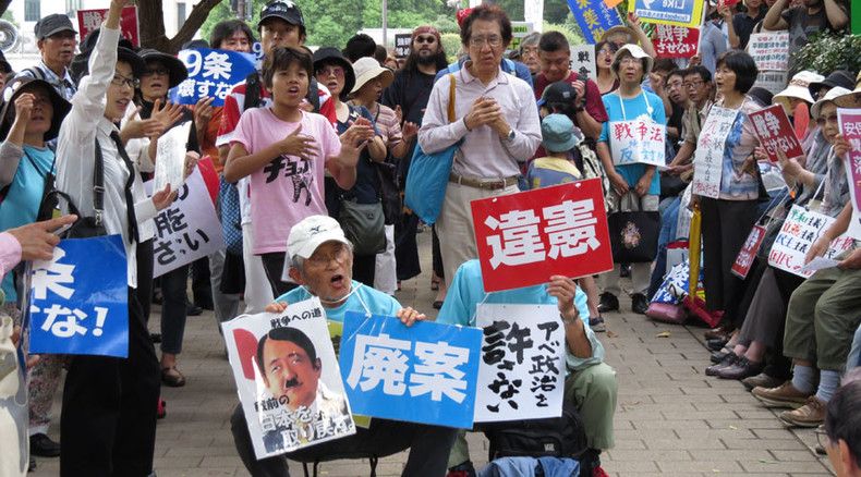 End of Japan's pacifism? Parliament approves war bills allowing troops to fight abroad