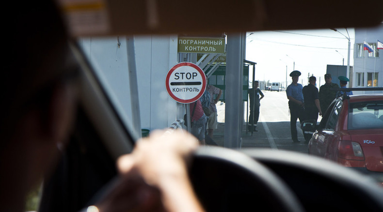 Trade blockade? Ukrainian activists block food trucks on checkpoints to Crimea