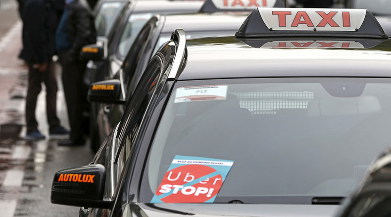 'Uber Out!' Belgian court bans ride-sharing UberPOP app, company to appeal