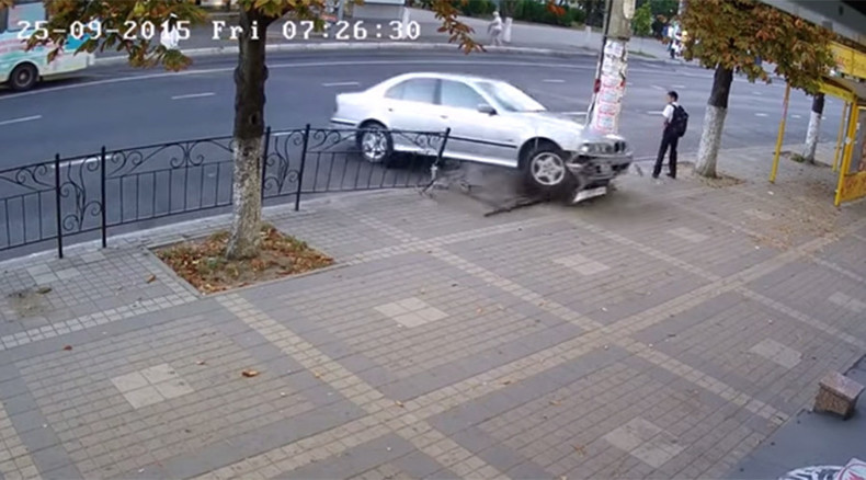 Narrow escape: Boy steps aside seconds before car slams into same place (VIDEO)