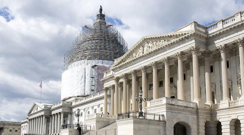 Govt shutdown dodged temporarily: Obama signs spending bill