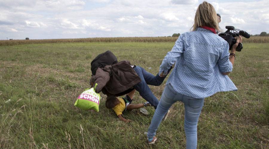 'My life is ruined': Refugee-tripping Hungarian camerawoman to sue Facebook, may move to Russia