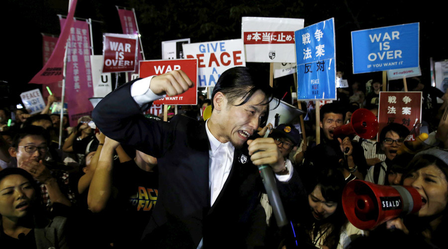 'War is over!' Scuffles in Tokyo as anti-military protesters rally against Abe policy
