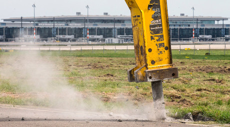 Reconstruction works on a northern runway of the future Berlin Brandenburg international airport Willy Brandt (BER) are conducted in Schoenefeld, Germany © Hannibal Hanschke