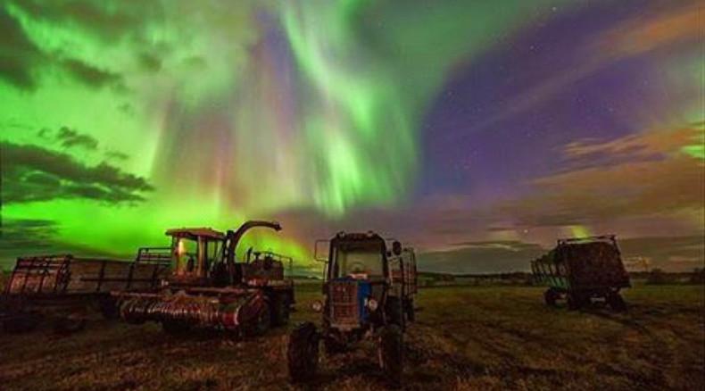 Deep purple: Cities across Russia illuminated by dazzling Northern Lights (PHOTOS)