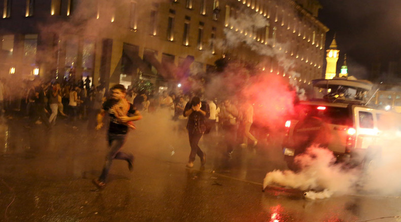 Police use tear gas, water cannon to break up protest in Lebanon's capital