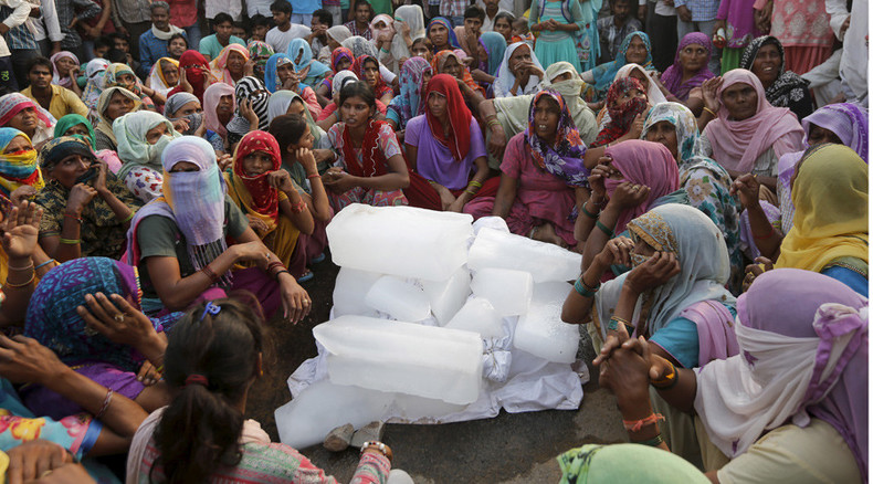 Hundreds of angry Indians block roads after two lower-caste children killed in arson attack