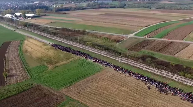 Drone captures thousands of refugees march in Slovenia (VIDEO)