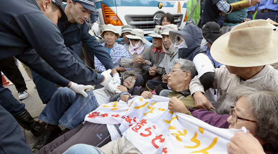 Japanese police drag away elderly protesters as work starts on controversial US airbase (VIDEO)
