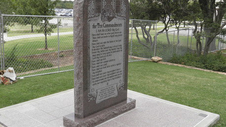 A Ten Commandants monument is seen in a fenced-off section of Oklahoma State Capitol grounds in Oklahoma City, Oklahoma, September 30, 2015. © Jon Herskovitz