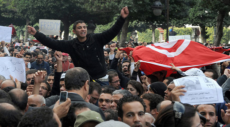Tunisian man shouts slogans during a demonstration in front the Interior ministry in Habib Bourguiba avenue in Tunis after Tunisian President Zine El Abidine Ben Ali's address to the nation on January 14, 2011. © AFP Photo