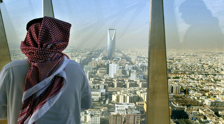 A man looks at central Riyadh from the Faisaliah Tower, Saudi Arabia. © Peter MacDiarmid