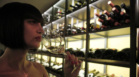 Customer Nadia Mavromataki, 35, tastes a glass of wine at Oinoscent wine bar in central Athens. © John Kolesidis