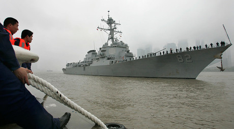 Chinese sailors look at the USS Lassen, a guided missile destroyer © Aly Song