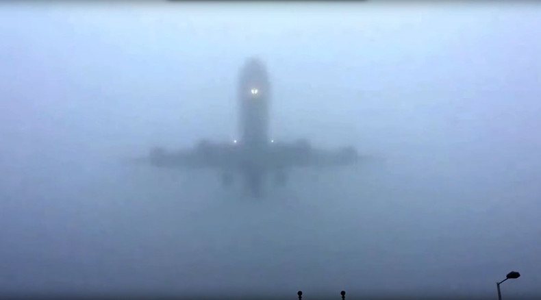 The mists of Avalon? Planes flying out of thick fog at Heathrow Airport (VIDEO)