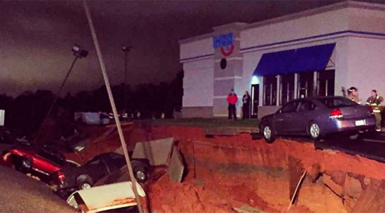 Mysterious giant sinkhole in Mississippi swallows at least 15 vehicles (PHOTOS)