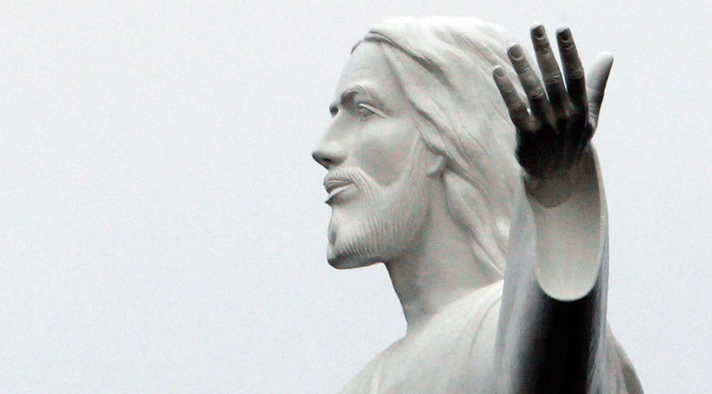 French priest smashes Jesus statue, blames job 'stress & fatigue'