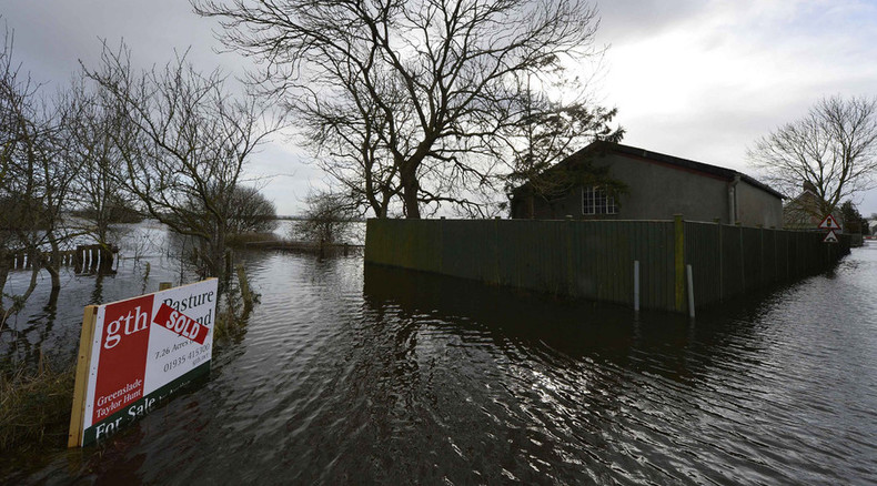 Troops deployed to build flood barriers as storms batter northern England