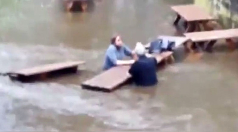 Wet your whistle: Hardy Yorkshire drinkers defy rising floodwaters to enjoy pint