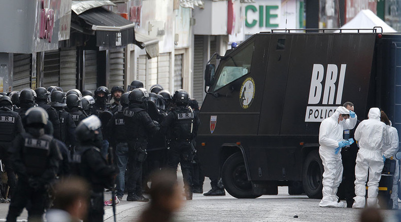 Paris shootout: 2 dead, incl. female suicide bomber, 7 arrested as police, army hunt suspects
