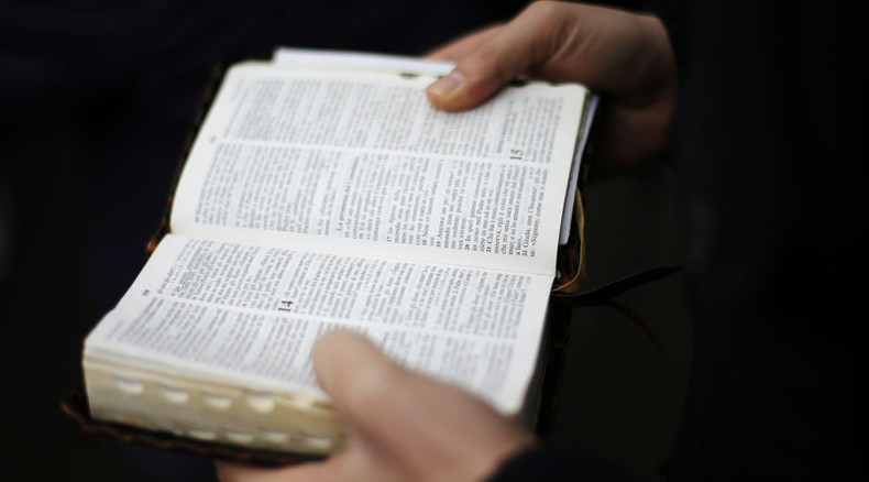 It's not in the Bible, nor in Koran: Putin signs law exempting holy books from extremism checks