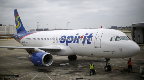 A Spirit Airlines airplane sits at a gate at the O'Hare Airport in Chicago, Illinois October 2, 2014. © Jim Young