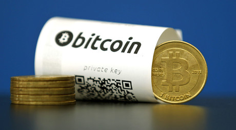 A Bitcoin (virtual currency) paper wallet with QR codes and a coin are seen in an illustration picture taken at La Maison du Bitcoin in Paris, France. © Benoit Tessier