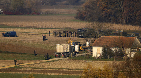 A view from Croatian village Vukovo Selo shows army trucks and soldiers at Slovenian village Veliki Obrez November 11, 2015. © Antonio Bronic