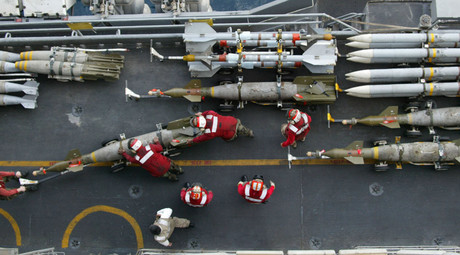 US Navy ordnance handlers move a 1,000-pound GBU-16 Paveway laser-guided bomb from the
