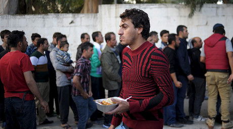 Refugees line-up during free food distribution at a temporary camp on the Greek island of Leros. © Fotis Plegas