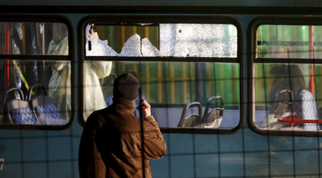Forensic personnel investigate a bus with windows broken by bullets after an attack in Sarajevo, November 19, 2015. © Dado Ruvic