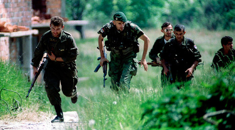 ARCHIVE PHOTO: Bosnian Serb soldiers run for cover during an operation near the northern Bosnian town of Brcko on the corridor connecting northern Bosnia with Serbia © Str