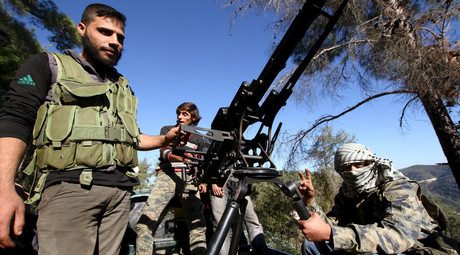 Syrian Turkmen fighters are seen with an anti-aircraft artillery weapon near the northern Syrian village of Yamadi, near the Turkish-Syrian border, Syria, November 24, 2015. © Stringer