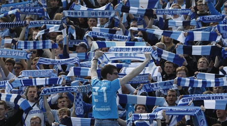 Zenit St. Petersburg fans hold scarves to support their team during a match in St. Petersburg May 6, 2012. © Maxim Shemetov