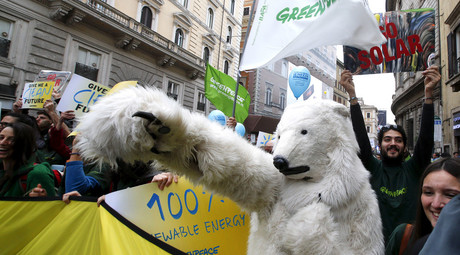 A protester dressed as a bear takes part in a rally held the day before the start of the 2015 Paris World Climate Change Conference, known as the COP21 summit, in Rome, Italy, November 29, 2015. © Alessandro Bianchi